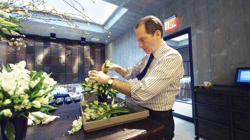 Charles Masson, director of Chevalier, arranges flowers.