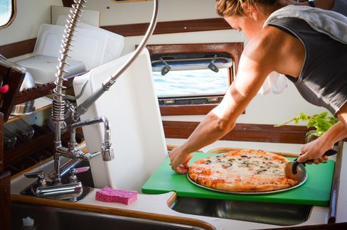 Many areas of the galley perform double duty to make the 12-by-16-foot space more efficient.