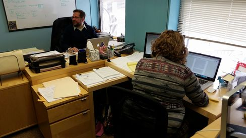 Mike Browne, deputy executive director, and Jenni Dye, research director, in a corner of the One Wisconsin Now offices in Madison, Wis.