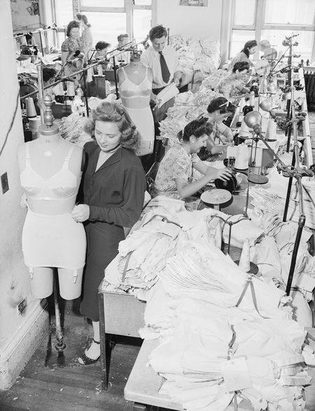 Clothing workers return to making girdles and brassieres at Flexes in the Garment District of New York City at the end of World War II, on Aug. 31, 1945.