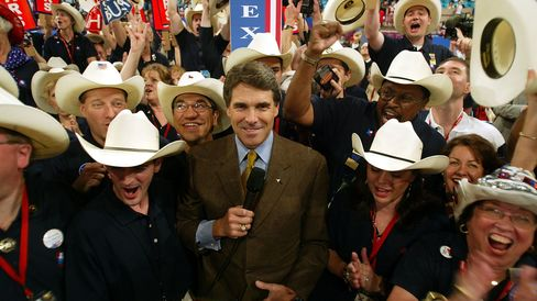 Rick Perry stands with Texas delegates as they cast their votes for President George W. Bush during the Republican National Convention on Aug. 31, 2004, at Madison Square Garden in New York City.