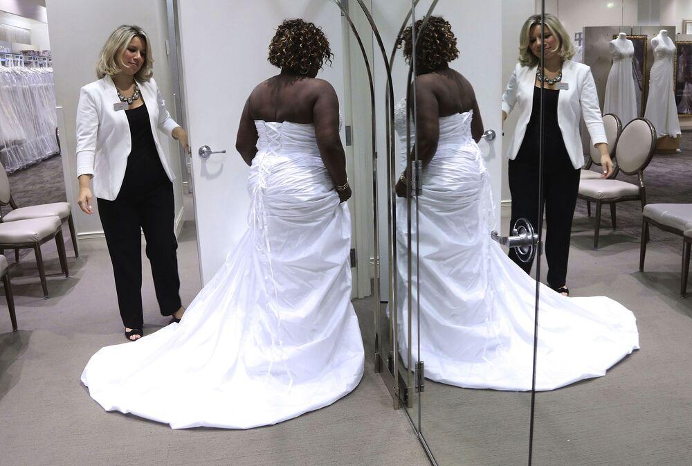 adb73bea984 A customer tries on wedding dresses at a David s Bridal in New York.