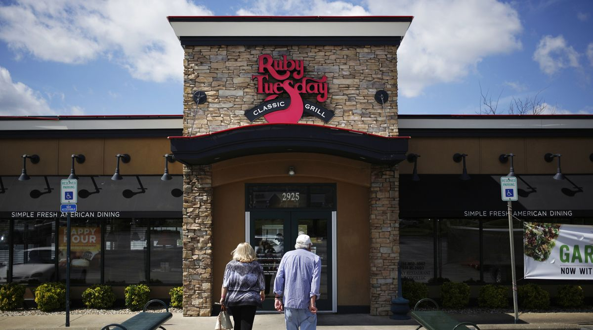Customers walk towards the entrance of a Ruby Tuesday restaurant in Bowling Green, Kentucky.