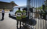 Members ofMoroccan security forces stand guard as a vehicle transporting the suspects charged over the murder of two Scandinavian women hiking in Morocco, drives outsidea court in Sale, near the capital Rabat on May 30, 2019.