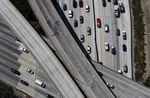 Vehicles move along the Interstate 405 freeway during rush hour in Los Angeles, California.