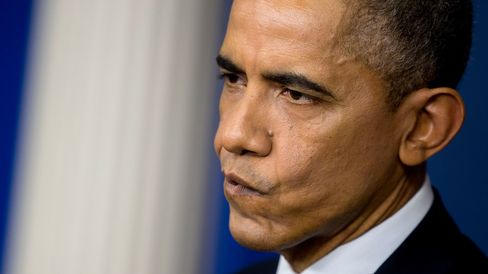 U.S. President Barack Obama listens to a question during a news conference at the White House in Washington, D.C., U.S., on Friday, Dec. 19, 2014.