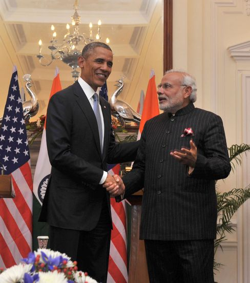 The prime minister, in the suit all of India was talking about, welcomes Barack Obama to the country.