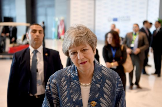 May Raises Stakes Before Brexit Showdown as EU Hatches Plot