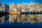 Amsterdam, Netherlands, Europe. Traditional old buildings reflected in the canal.