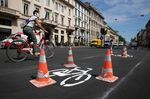A cyclist passes a newly-marked cycle lane in Milan.