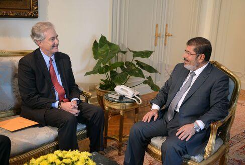 Egypt's President Mursi Reinstates Parliament, Orders Vote