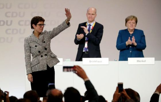 Merkel's Favored Candidate Wins CDU Party Race: Germany Update