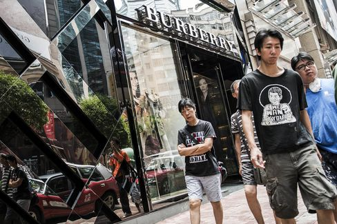 Shoppers In Causeway Bay As Gucci Spars With Hong Kong Landlords Amid Slumping Chinese Demand