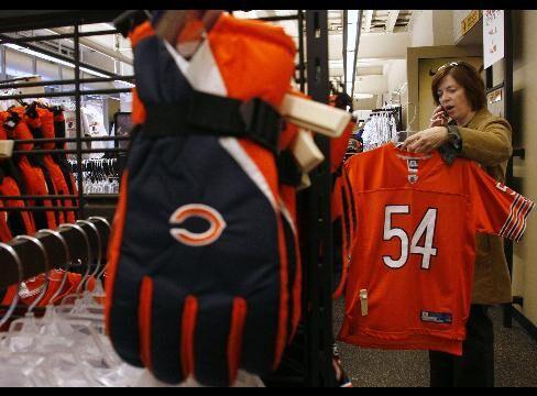 Lori Yoder shops for a Chicago Bears Brian Urlacher jersey