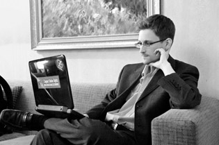 A sticker on Edward Snowden's laptop shows a purple and white onion