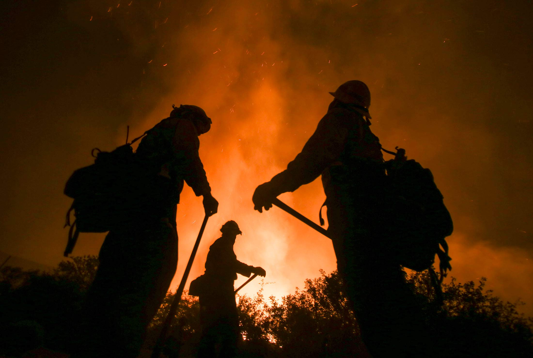 Firefighters battle the Blue Cut wildfire near Cajon Pass, north of San Bernardino, California, on Aug. 16, 2016.