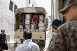 Men stand next to ballot boxes and election materials in a truck, during presidential elections in Tunisia on Sept. 15.