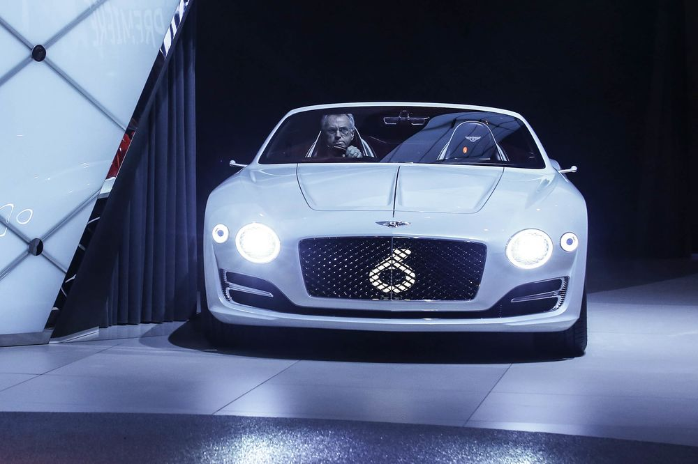 The Bentley Motors Exp 12 6e Concept Convertible Hybrid Automobile Is Driven Onto Stage On