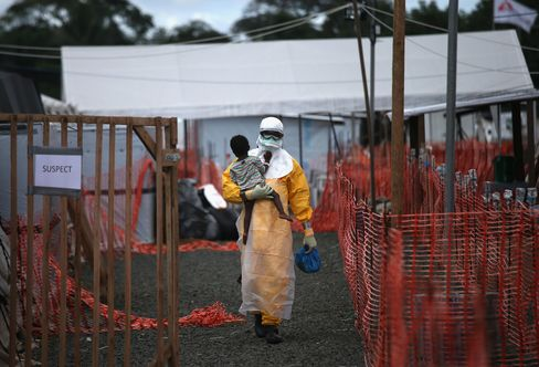 A Health Worker Carries a Child Suspected of Having Ebola