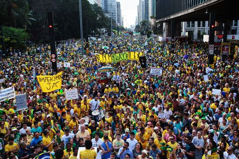 Demonstrators hold banners and signs during a protest in Sao Paulo on Sunday.