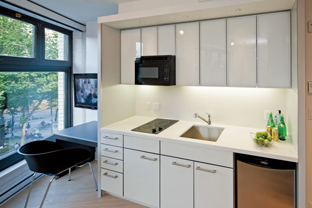 Micro apartments in the big city a trend builds bloomberg for Micro living apartment