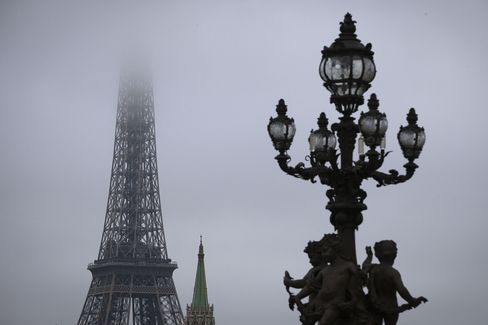 The Eiffel Tower sits in smog