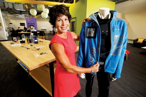 Sargent with Flex's smart jacket. More than 60 sensors and components are built in. Background: Startups working at Flex's accelerator.
