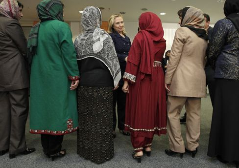 Clinton meets with delegates from an Afghan women's civil society during the Afghanistan Conference on Dec. 5, 2011.