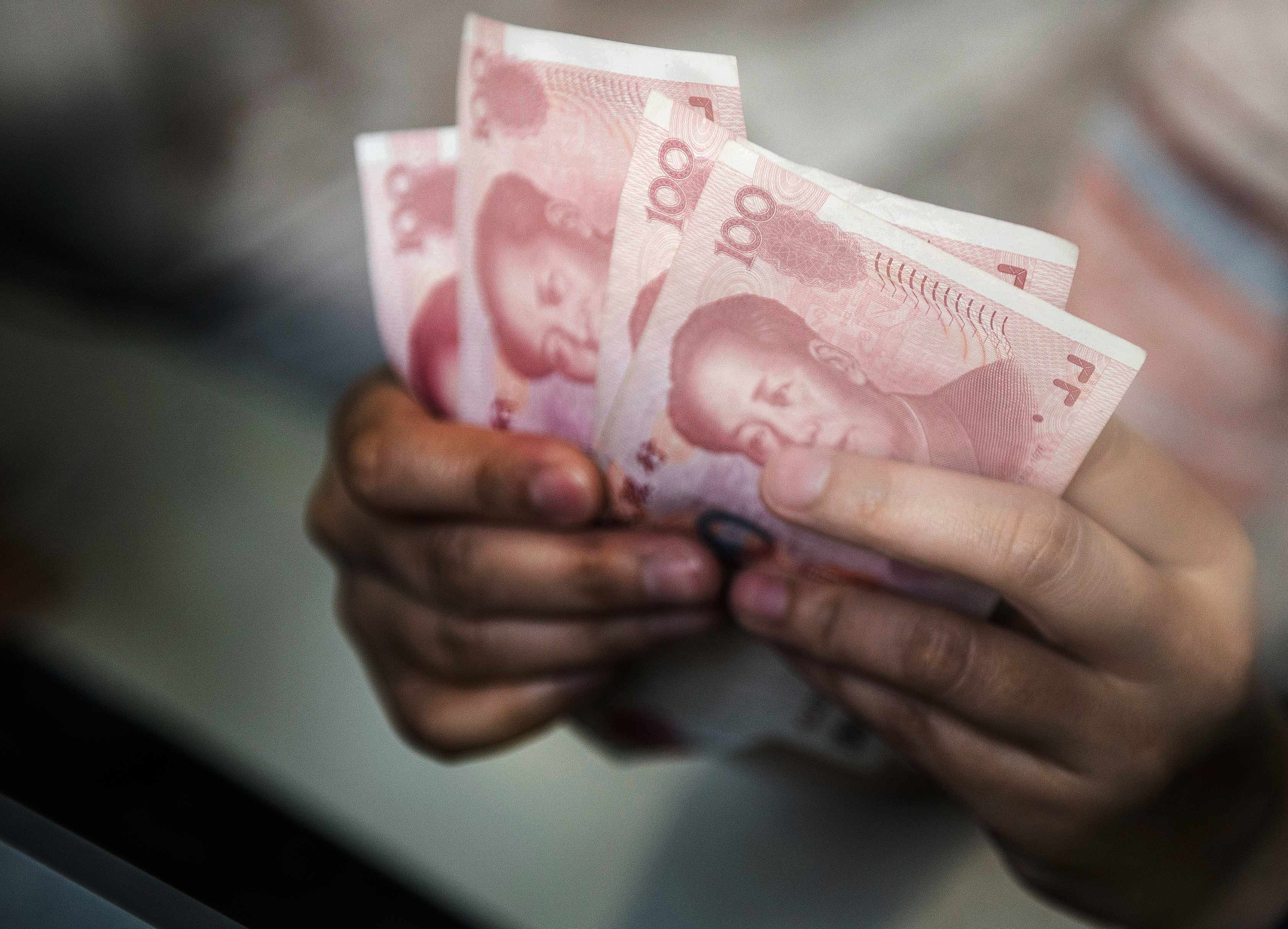 Let the Market 'Truly' Decide Yuan Rate, PBOC Adviser Huang Says - Bloomberg