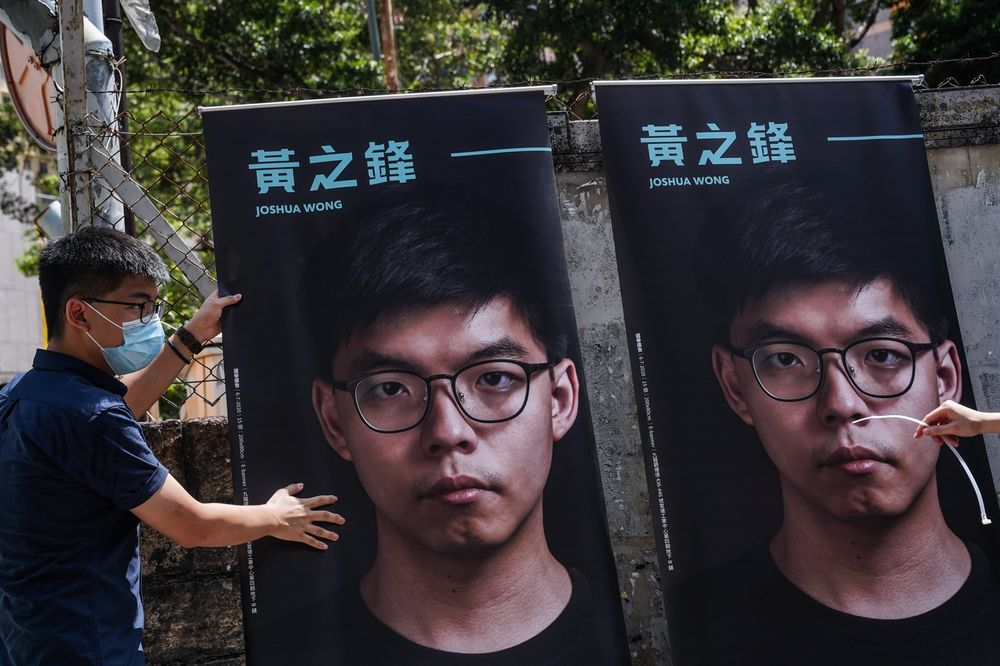 Posters of pro-democracy activist Joshua Wong .