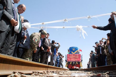 Afghanistan's first cargo train from China approaches to cut the ribbon.
