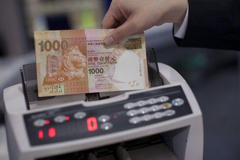 Hong Kong Peg Architect Says Convertible Yuan `Long Way Off'