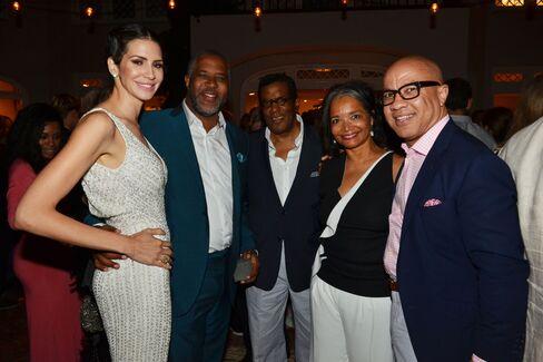 Hope and Robert Smith of Vista Equity Partners, Frederick Terrell, Apollo Theater CEO Jonelle Procope, Darren Walker