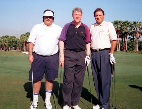 Hugh Rodham, Hillary Clinton's brother, enjoyed a golf outing with then-president Bill Clinton and golf star Raymond Floyd at Miami's Fisher Island Golf Course in 1994.