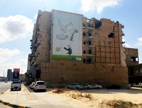 A poster showing a peace dove adorns a building on Tripoli Street in Misrata, Libya.