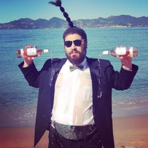 Ostrovsky pouring rosé on himself at 7 a.m. during the Cannes Film Festival. Because he can.
