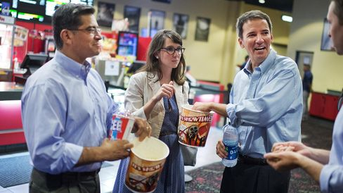 Andrew Romanoff (right), Democratic candidate for Colorado's 6th Congressional District, joins aide Denise Baron and Representative Xavier Becerra of California on a tour of Cinema Latino by co-owner Louis Sullivan in Aurora, Colo., on Aug. 26, 2014.