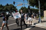 Employees walk across Blizzard Way during a walkout at Activision Blizzard offices in Irvine, California on July 28,.