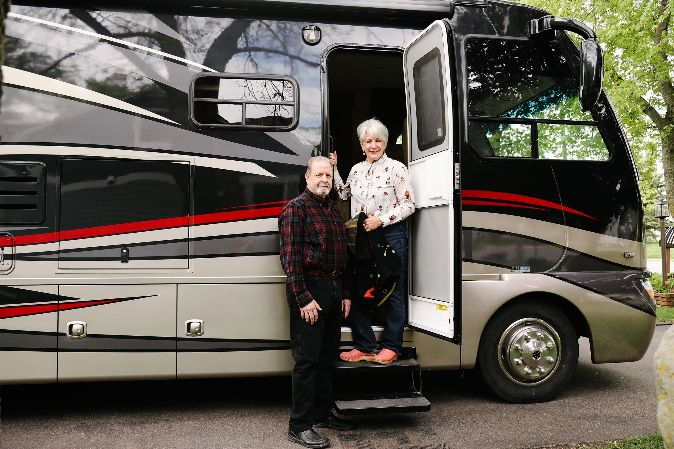 Jeff and Pam Sandberg pose with their new RV from Hilltop Camper and RV in St. Paul, Minnesota, May 20, 2020.