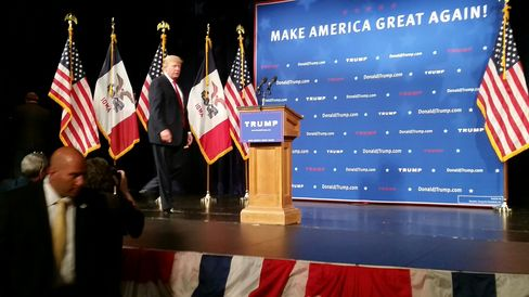 Donald Trump takes the stage in Des Moines for a campaign appearance.