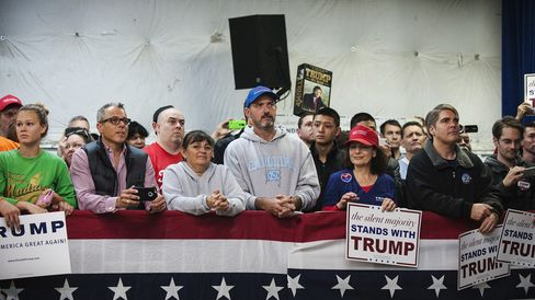 Attendees listen as Donald Trump speaks during a campaign event at the Prince William County fairgrounds in Manassas, Virginia, on Dec. 2, 2015.