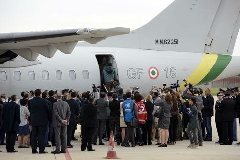 Eritrean refugees board a plane heading for Sweden at Ciampino airport in Rome.