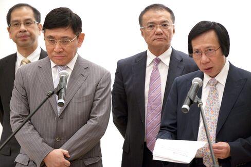 Sun Hung Kai Properties Co-Chairman Raymond Kwok And Thomas Kwok