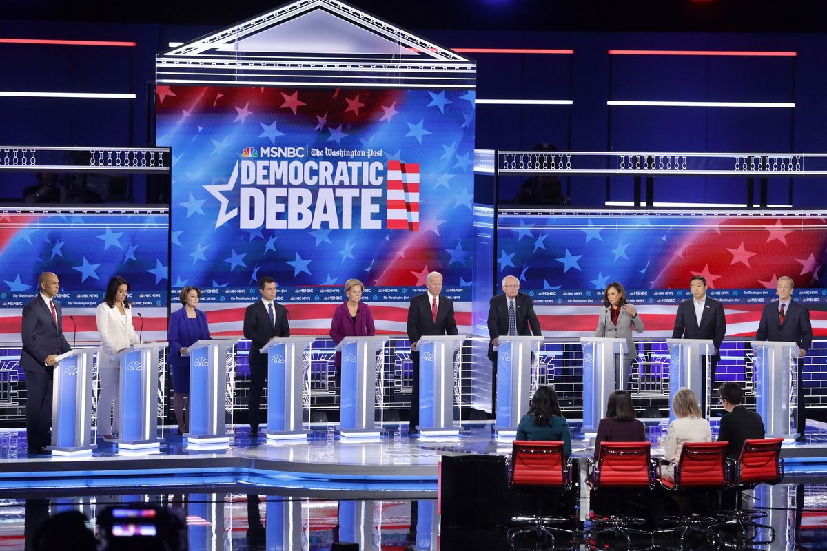 Warren Targeted on Debate Stage for Wealth Tax, Medicare for All