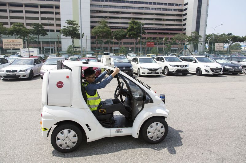 A driverless vehicle used for delivering cargo documents at Changi Airfreight Terminal in Singapore. Photographer: Ore Huiying/Bloomberg