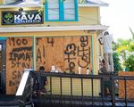 Employees of the Island Root Kava Lounge board up the windows of the business in preparation for Hurricane Dorian in Melbourne, Florida, U.S.