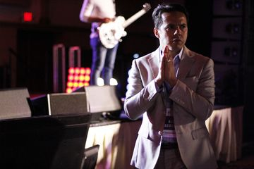 Reverend Samuel Rodriguez prays at the National Hispanic Christian Leadership Conference on Tuesday in Houston.