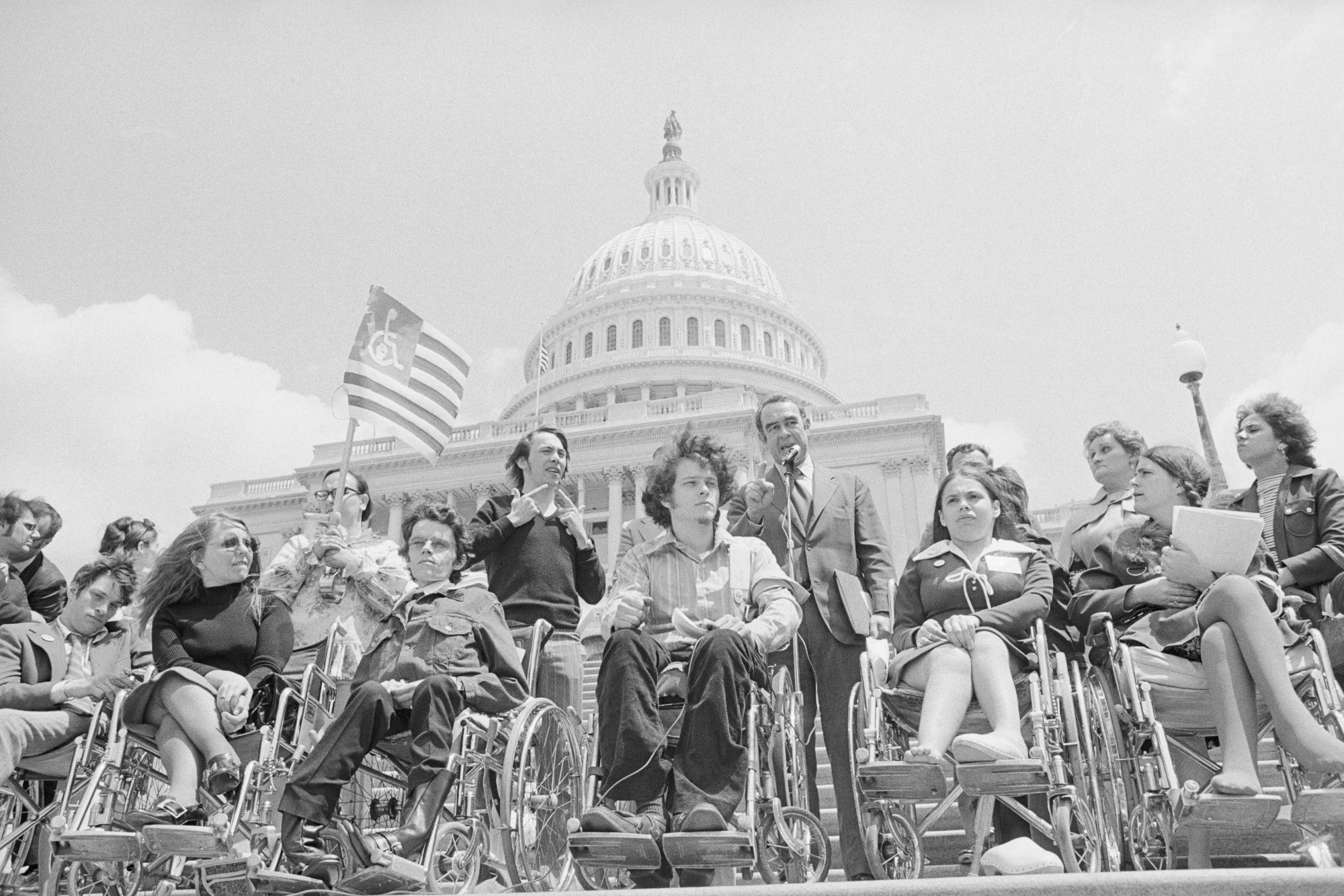 """Protesters lobbying for an """"Equal Rights Proclamation"""" fordisabled peopleat the U.S. Capitolin 1972. Among their demands were curb cuts at street corners and better access to public transit. The Americans with Disabilities Act mandated curb cuts in 1990."""