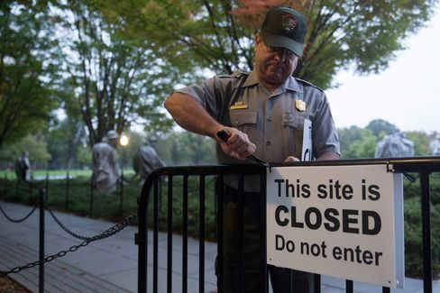 National Park Service park ranger Richard Trott removes a closed sign at the Korean War Veterans Memorial after a two-week shutdown of government services in 2013.