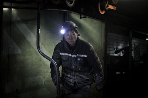 A miner exits a tunnel at the end of his shift at a coal mine in Liulin, China.